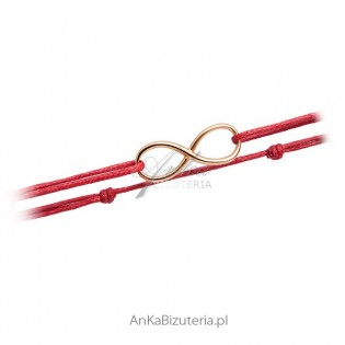 Bransoletka złota nieskończoność na czerwonym sznureczku