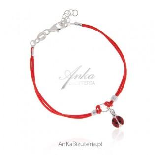 Bransoletka dla dziewczynki srebrna na czerwonym sznureczku