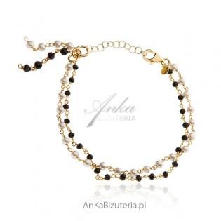 Bransoletka srebrna pozłacana z białymi perełkami i czarnymi onyksami
