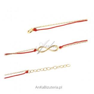 Bransoletka srebrna pozłacana nieskończoność na czerwonym sznureczku