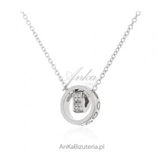 """Naszyjnik srebrny z """"tańczącym serduszkiem"""" i cyrkoniami"""