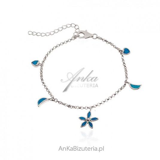Srebrna bransoletka z przywieszkami z niebieskim opalem
