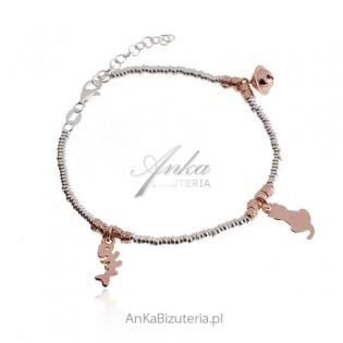 Srebrna bransoletka z przywieszkami z różowym złotem