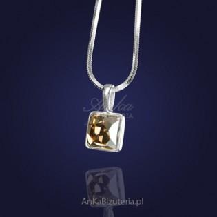 Swarovski-Wisiorek z kryształem Swarovskiego w kolorze Golden Shadow-elegancki złoty odcień.