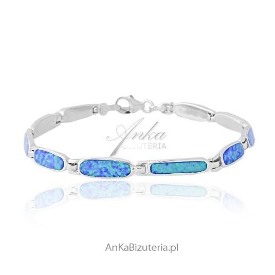 Śliczna niespotykana biżuteria - bransoletka srebrna z niebieskim opalem.